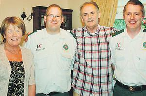 Stephen wife Geraldine and paramedics Tony Murphy and Dominic McEvoy who saved his life