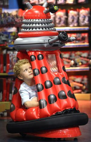 LONDON, ENGLAND - JUNE 28:  Archie Twigg 5, sits in a 'Dr Who Ride in Dalek' motorised Dalek during a Hamleys Christmas toy photocall at Hamleys Toy store on June 28, 2011 in London, England. The famous toy store unveiled today their 'must have' toys for Christmas 2011.  (Photo by Dan Kitwood/Getty Images)