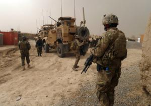 US soldiers keep watch at the entrance of the military base near Alkozai village following the shooting. Photo: Getty Images