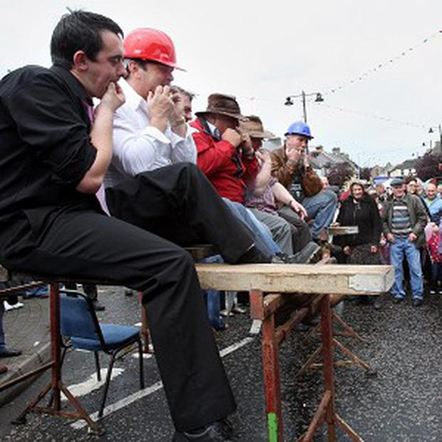 Competitors take part in a wolf-whistling competition in Irvinestown, Co Fermanagh