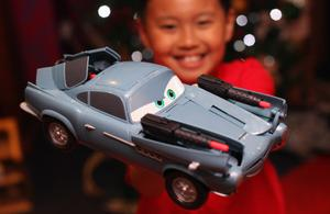 LONDON, ENGLAND - JUNE 28:  Rio Nuyen 8, holds a 'Cars 2 Fully Loaded McMissile' car during a Hamleys Christmas toy photocall at Hamleys Toy store on June 28, 2011 in London, England. The famous toy store unveiled today their 'must have' toys for Christmas 2011.  (Photo by Dan Kitwood/Getty Images)