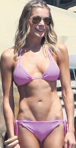 Singer Le Ann Rimes in Malibu showing off her Victory 'V' lines.