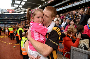 Henry  lifts and hugs his daughter Sadhbh.