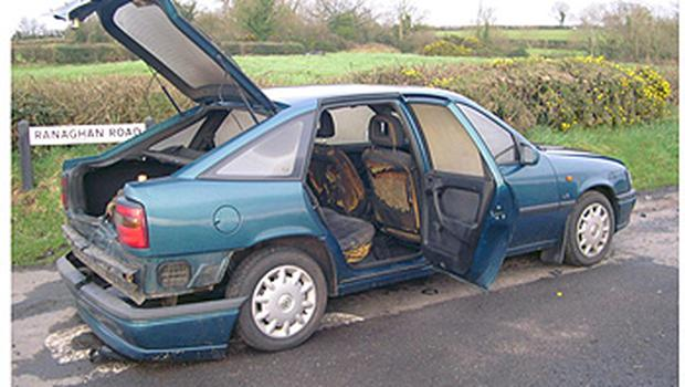 A handout photo issued by PSNI of a green Vauxhall Cavalier car thought to have been used by the gang, which they failed to burn on Ranaghan Road, about 12km from Massereene