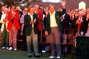 Jack Nicklaus receives the green jacket from Bernhardt Langer after winning the 1986 tournament. Photo: Getty Images