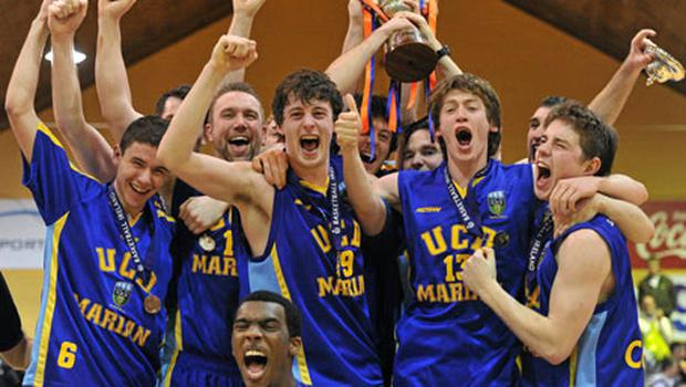 The UCD Marian team celebrate with the cup after defeating Killester at the National Basketball Arena. Photo: Brendan Moran / Sportsfile