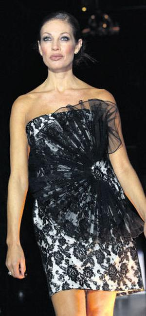 Sheila Eustace wears a black/white strapless short dress with tulle, from Kabuki