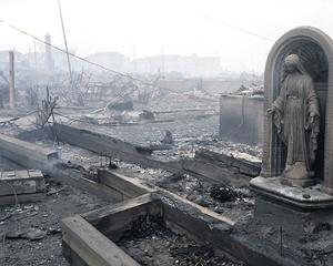 A statue of the Virgin Mary stands where homes in Breezy Point, Queens, were destroyed
