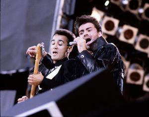 Andrew Ridgeley and George Michael of Wham! perform on stage at 'The Final Concert', Wembley Stadium, London, 28th June 1986. (Photo by Michael Putland/Getty Images)