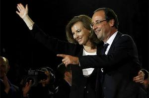 French president-elect Francois Hollande reacts to supporters with his companion Valerie Trierweiler after greeting crowds gathered to celebrate his election victory in Bastille Square in Paris. Photo: AP