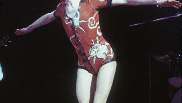 David Bowie performing as Ziggy Stardust, in his 'woodland creatures' costume designed by Kansai Yamamoto, at the Hammersmith Odeon, 1973. (Photo by Debi Doss/Hulton Archive/Getty Images)