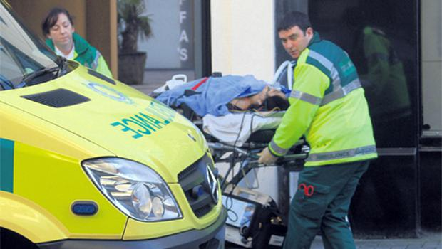 Paramedics move one of the victims from the scene of the double stabbing at Fitzwilliam Court, Dyer Street, Drogheda, Co Louth, yesterday