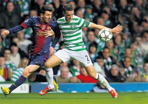 Celtic's Adam Mathews holds off Barcelona's Lionel Messi during the Champions League clash at Celtic Park last night
