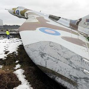 North East Aircraft Museum owner and manger Keith Davison examines the 1961 Avro Vulcan jet, which has tipped on its tail after heavy snow