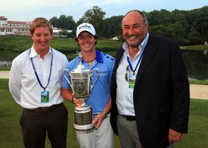 Rory McIlroy holds the trophy next to Stuart Cage (L) and Chubby Chandler after his eight-stroke victory during the 111th US Open at Congressional Country Club on June 19, 2011. Photo: Getty Images