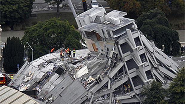 The collapsed Pyne Gould Guinness Building in central Christchurch where one of the missing Irish pair is believed to be trapped. Photo: AP