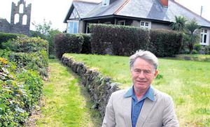 Unique: Rex Coughlan standing before his Howth home