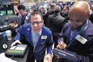 Traders working on the floor of the New York Stock Exchange .
