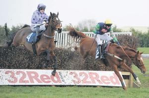Wayne Hutchinson manages to stay aboard odds-on favourite Lidar during the novice chase at Doncaster yesterday