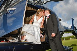 Newlyweds Alma Daly and Ger Rafferty share a kiss as the bride prepares to take to the skies after their wedding ceremony at St Manchan's Church in Boher, Co Offaly, on Saturday