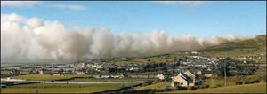 Smoke from a gorse fire billowing over Dingle on Friday afternoon. Credit: Photo by Ted Creedon