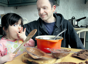 A kitchen eggs-travaganza: John Cradden and his daughter Ana, hard at work making their own Easter eggs. Photo by Ronan Lang