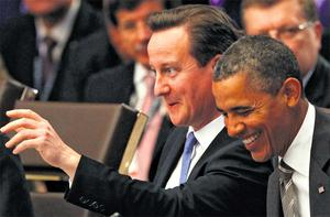 British Prime Minister David Cameron and US President Barack Obama share a laugh during the opening session of the heads of state meeting on Afghanistan at the NATO Summit in Chicago yesterday. Photo: Reuters