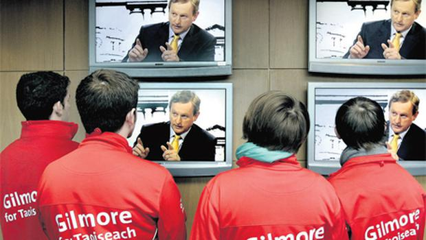 Members of Eamon Gilmore's campaign team , from left, Kingsley Kelly, Conor Ryan, Hannah Deasy and Sam Ryan listen to Enda Kenny in studio during the TG4 debate in Connemara yesterday morning