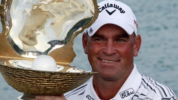 Denmark's Thomas Bjorn poses with the winning trophy after yesterday's victory in the Qatar Masters at Doha GC. Photo: Reuters