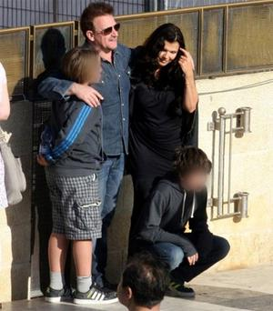 Bono in Jerusalem with wife Ali and sons  Elijah and John