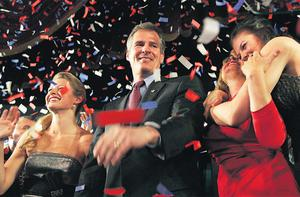Republican candidate for the US Senate Scott Brown celebrates with his daughters Arianna (left) and Ayla (right) along with his wife Gail