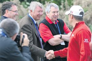 Manchester United manager Alex Ferguson shakes hands with Lee Westwood at the Scottish Open during a rare day off