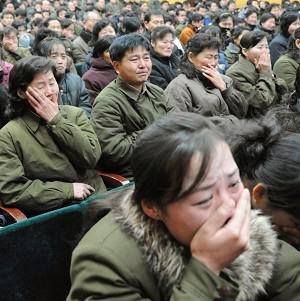 North Koreans cry after learning of the death of their leader in Pyongyang (Kyodo)