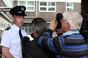 Chief Inspector Jon Burrows, the PSNI area commander for Foyle, speaks to the media. Photo: PA