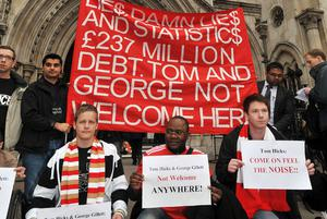 A group of Liverpool football club supporters gather outside the High Court in central London this morning. Photo: PA