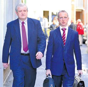 Former Garda Tarrant (left) leaving court in Navan yesterday with his solicitor Cahir O'Higgins