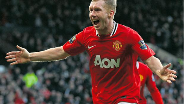 Paul Scholes celebrates after scoring for Manchester United at Old Trafford