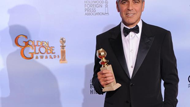 The winner for Best Performance by an Actor in a Motion Picture Drama George Clooney poses with the trophy. Photo: Getty Images