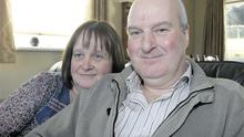 Cork crash survivor Lawrence Wilson in his living room yesterday with his wife May