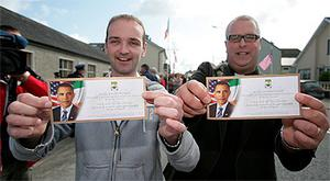 Henry Healy and Canon Stephen Neill with their tickets for the visit of Barack Obama to Moneygall in May last year
