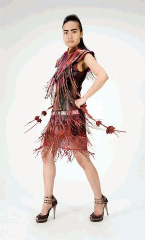 PVC, leather and knit dress, €889; tubular fringed collar, €389, both Claire Garvey. Shoes, stylist's own.