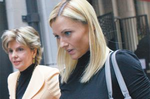 Former porn actress Ginger Lee (right), with her attorney Gloria Allred, following a news conference in New York yesterday about Ms Lee's correspondence with New York Representative Anthony Weiner