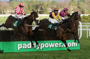 Big Zeb (right) ridden by Robbie Power goes on to win The Paddy Power Dial-a-Bet Steeplechase during the Christmas Festival at Leopardstown. Photo: PA