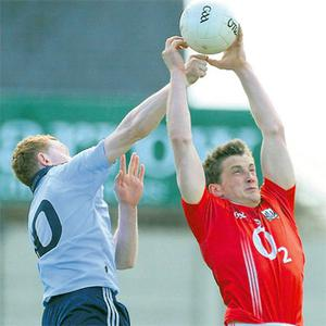 Dublin wing-forward Ciaran Reddin tries to punch the ball away from Cork's Eoin Healy during the All-Ireland U-21 FC semi-final at O'Moore Park