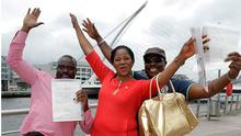 Bisi Emmanuel[ left] and his wife Yemi and Oluwasegun Olatuyi all celebrate after they  recieved Irish Citizenship at the Citizenship Ceremony at the Convention Center Dublin yesterday.