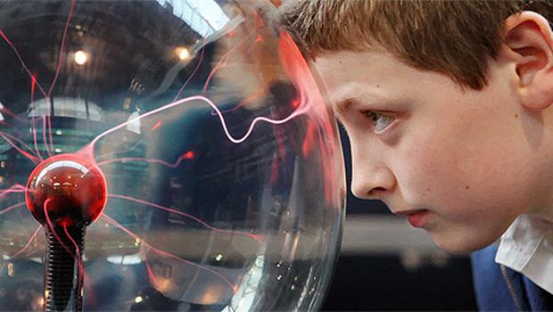 Brendan O'Grady from Limerick looking into a tesla ball at the Young Scientist exhibition