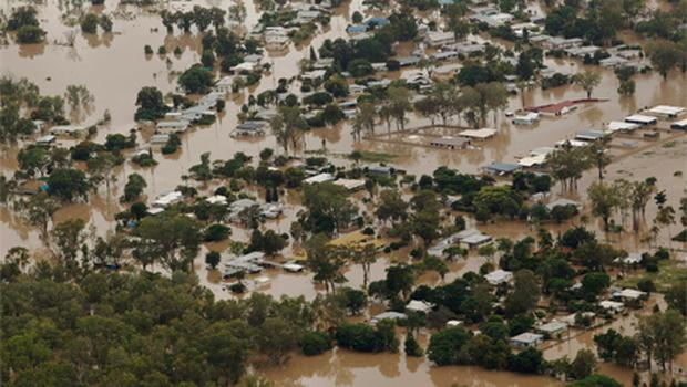 An aerial view of partially submerged houses in flooded Theodore in Australia' s state of Queensland
