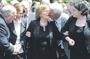 Brian Lenihan's mother Ann is comforted at his funeral yesterday