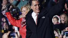 Republican presidential candidate Mitt Romney and his wife Ann wave to supporters at a campaign rally in West Chester, Ohio (AP)