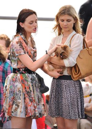"""Leighton Meester (L) on location for """"Gossip Girl"""" at Gantry Plaza State Park on August 9, 2010 in New York City."""